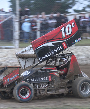 DIRTY WORK: Nathan Astle cleans mud off his sprintcar in round one of the WOW South Island series last weekend.