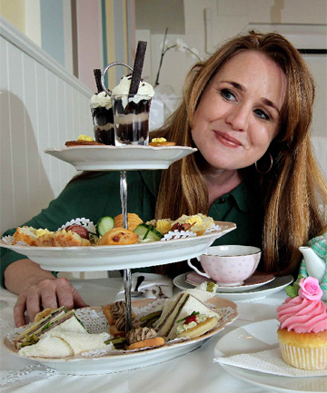 Leanne Wickham with the three-tiered plate at Petone's Sweet Pea.