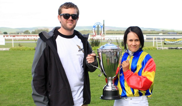 WINNERS: Part-owner Ryan Prince and jockey Kylie Williams hold the Winton Cup.