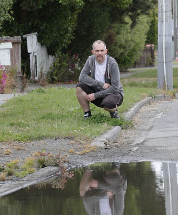 DANGEROUS EYESORE: Richard Clark questions why he and other red-zoners are still paying rates when their properties, footpaths and streets are in such appalling condition.