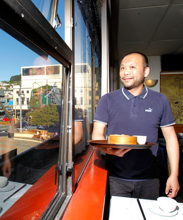 FAN SITE: Regal Chinese Restaurant owner Oliver Lai says the Courtenay Place eatery has been booked out for The Hobbit premiere.