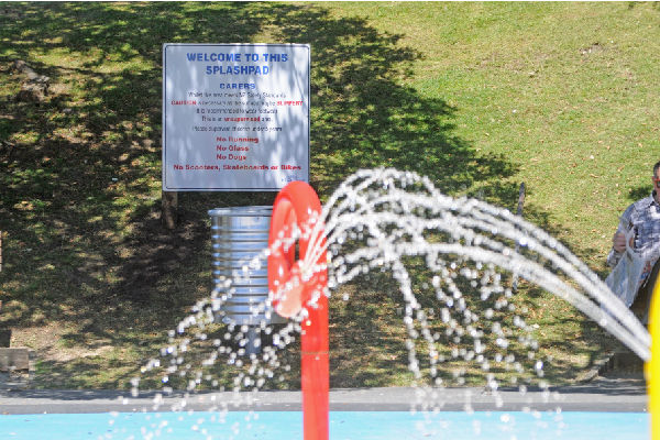 Slippery when wet: A sign at the new splash pad at Raumati's Marine Gardens yesterday.