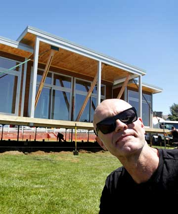 POP-UP BACH: Pop-up bach: Puke Ariki exhibitions manager Gerard Beckinsale with the Lockwood prefab that makes up part of the exhibition KiwiPrefab: Cottage to Cutting Edge.