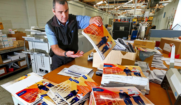 BEHIND BARS: David Blake working in Wellington Prison's printing room where, brochures for public and private companies are printed using prison labour.