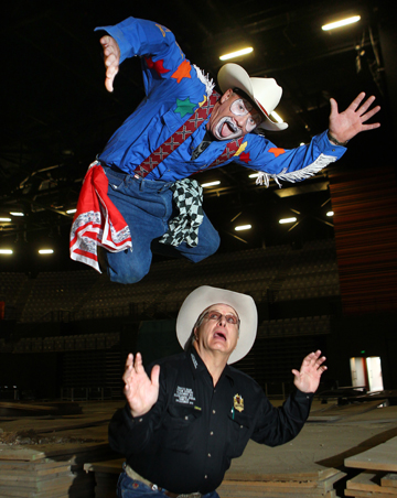 UPSTAGED AGAIN: Rodeo clown Big Al Wilson leaps over announcer Kedo Olson at Hamilton's Claudelands Arena.