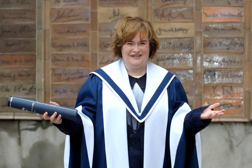Looking swish as she receives an honorary degree at Queen Margaret University in Edinburgh.