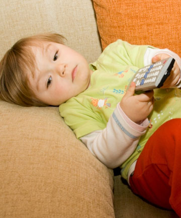 DOWN TIME: Letting your kids watch TV while you sleep-in is no bad thing, according to the Sh*tty Mum parenting guide.