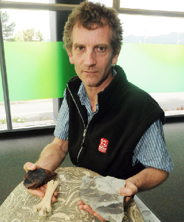 Educator's lament:  GNS educator Julian Thomson says a bagfull of ancient rock samples and fossils - such as the moa bone, volcano ''bomb'' (basalt spewed from an Antarctic volcano) and fossilised leaves he is holding - were stolen from his car over
