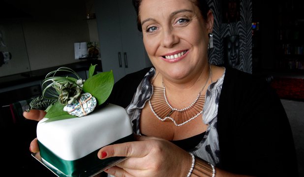 SPECIAL GIFT: Liz King with the piece of cake she sold from Prince Charles' Government House birthday bash. Photos: FAIRFAX NZ
