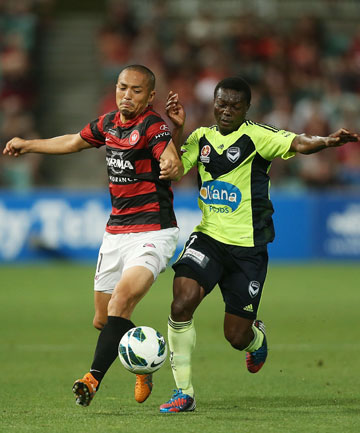 GRITTY WIN: Shinji Ono of the Wanderers and Adama Traore of the Victory compete for the ball. The Victory won the game 2-0.