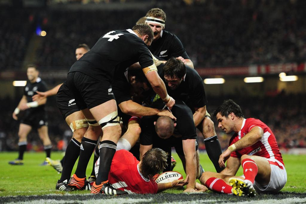 The All Blacks gather round Tony Woodcock after he scored in the first half.