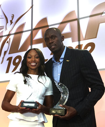 ON TOP: Usain Bolt and Allyson Felix with their awards.