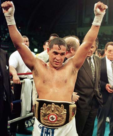 "Wearing his championship belt, Hector ""Macho"" Camacho celebrates his fifth round victory over Sugar-Ray-Leonard in their IBC middleweight title fight in Atlantic City, New Jersey in 1997."