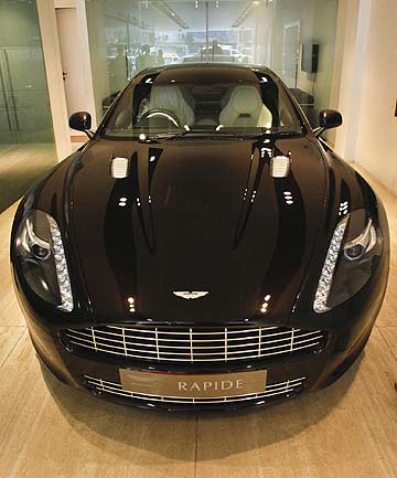 LUXURY CAR: A 2012 Aston Martin Rapide in an Indian showroom.