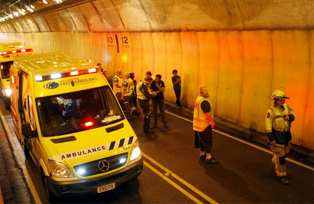 THE WAY IS SHUT: Emergency services in the Mt Victoria tunnel following a multi-car crash.