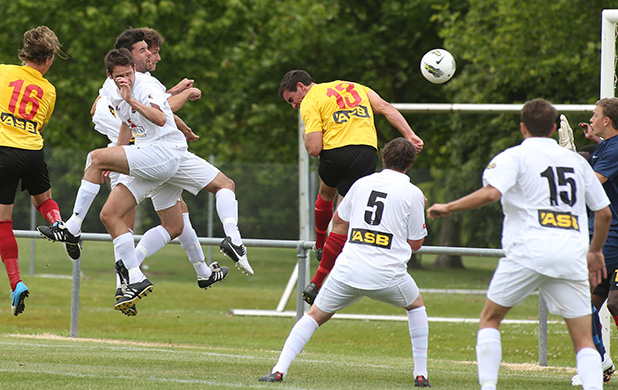 Canterbury United's Russell Kamo, third left, heads home the opening goal against Waikato FC at Centennial Park yesterday.