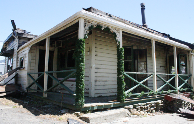 Gutted: Christmas tinsel is unscathed by the fire that ripped through this Waikawa house just after midnight yesterday