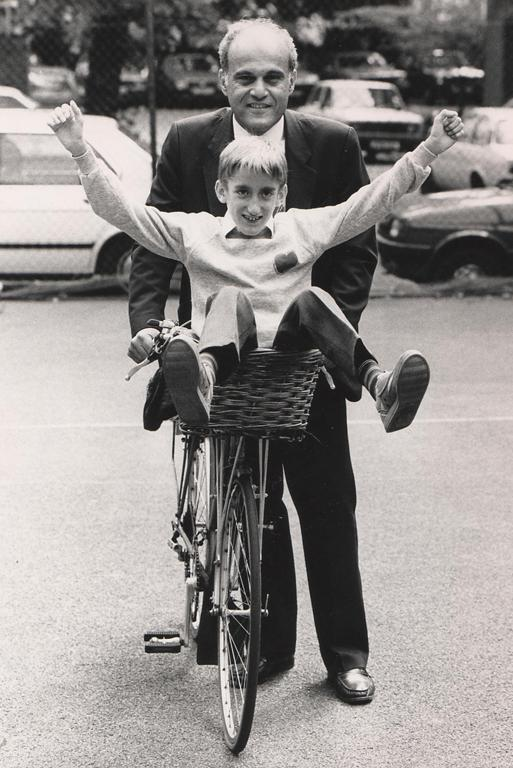 WHEELED ABOUT: This photo remains a mystery. Can you name these fellows sharing a bicycle ride?