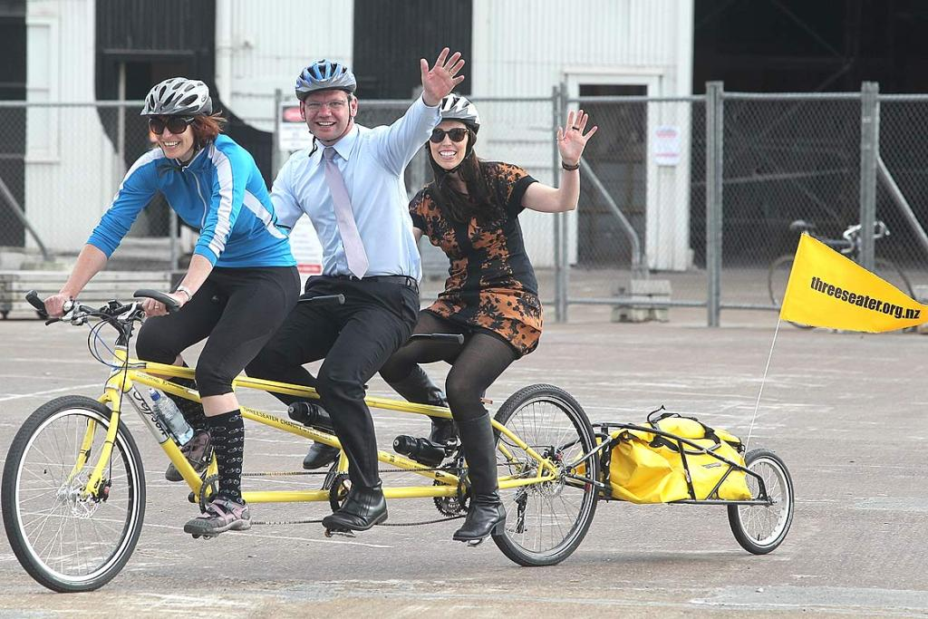Labour MPs Iain Lees-Galloway and Jacinda Ardern join Byrdie Johnston, front, on an Auckland leg of the charity bike ride.