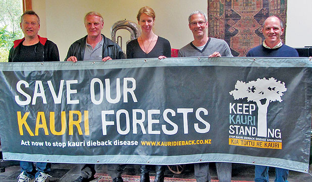 KAURI TEAM: Helping save kauri are, L-R, Coopers Creek cellar door manager John Palmer, Kauri Dieback Programme members Ian Mitchell, Stacey Hill, Nick Farland, and Coopers Creek GM David Nicholas.