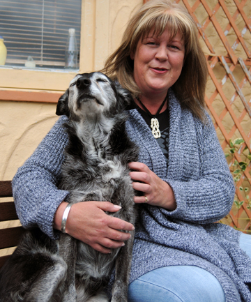 Back home: Lisa Miller with Holly – returned thanks to the kindness of a stranger.