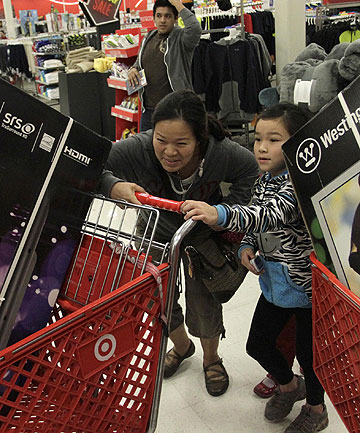 BIG BUY: A woman and her daughter push a heavy shopping cart at Target on the Thanksgiving Day holiday in Burbank, California.