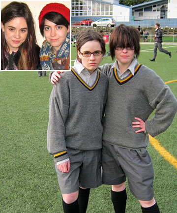 Tess Norquay, left, and Julia Holden dressed as boys in Wellington College uniforms