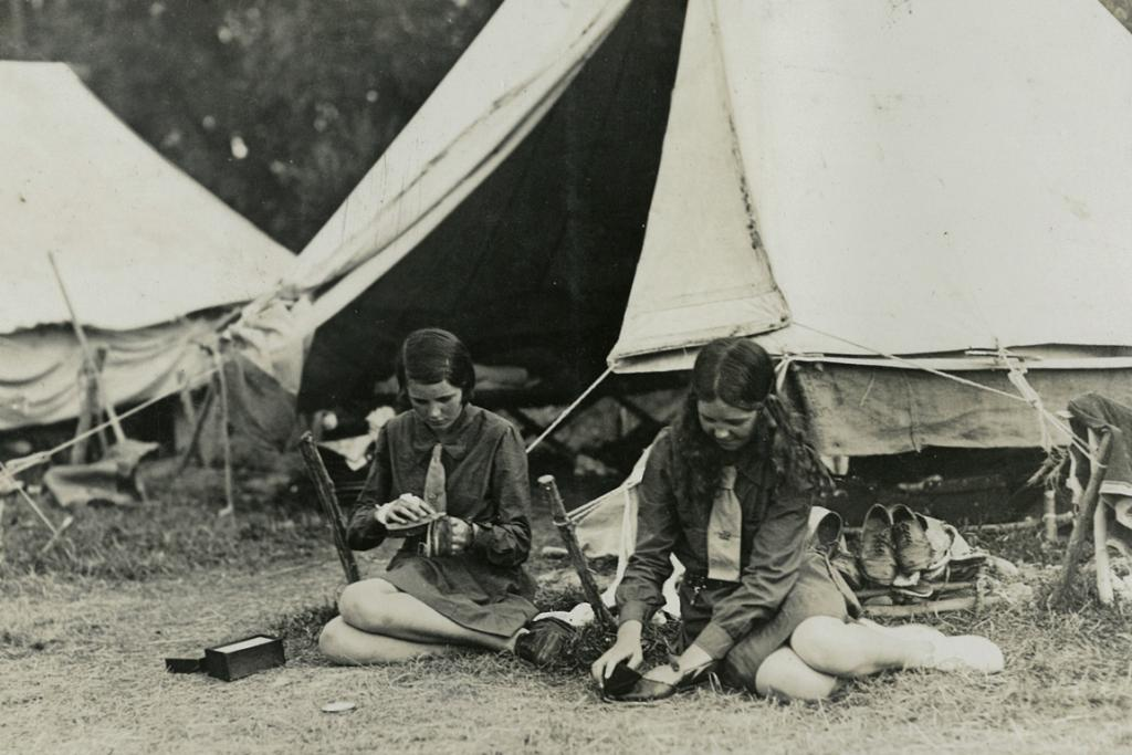 GONE CAMPING: Early girl guides and brownies of Timaru still had to do the daily chores while on camp, believed to be the 1920s.