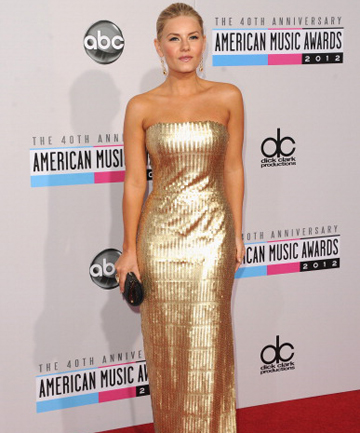 GOLD STANDARD: Elisha Cuthbert goes for gold at the American Music Awards.