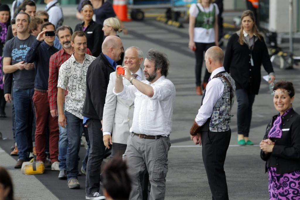 The Hobbit stars at Wellington Airport, with Peter Jackson taking a photo.