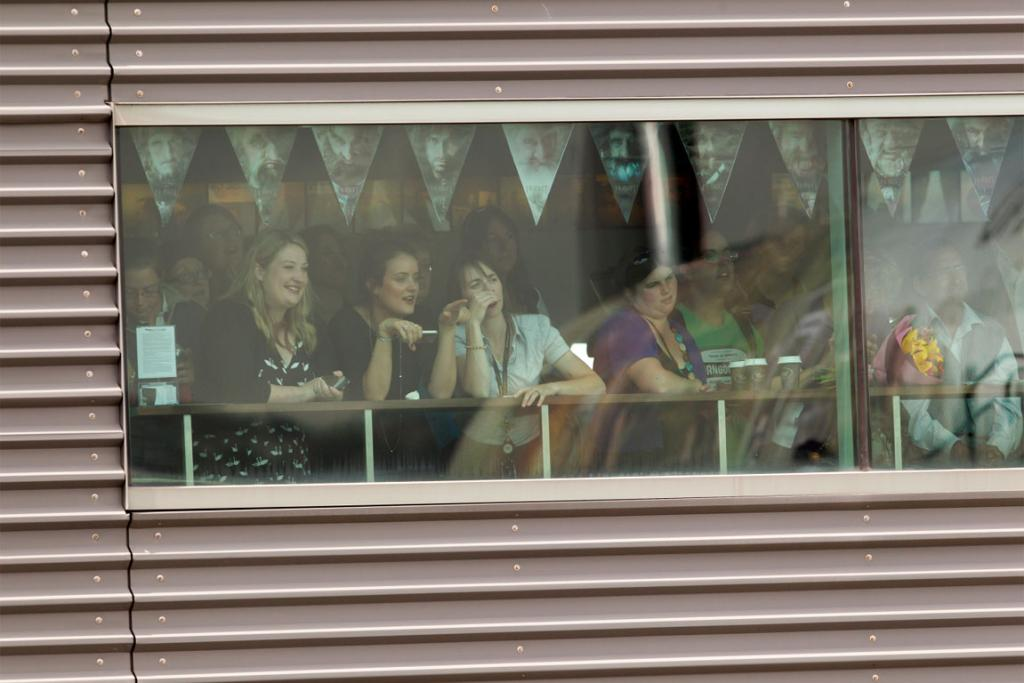 People watch from Wellington Airport's terminal as cast and crew of The Hobbit arrive from Auckland.