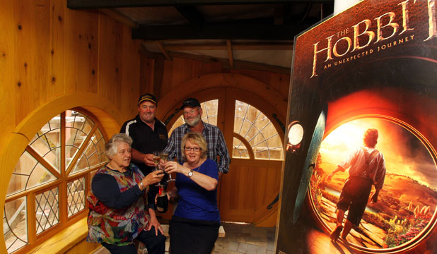 HERE'S TO JRR: From left, Marcia Vosper, who played a hobbit in The Fellowship of the Ring,  Russell Alexander  of Hobbiton Movie Set Tours, The Hobbit art director Brian Massey,  and Sue Whiting, manager of Matamata i-Site, toast what Tolkien's stories have done for Matamata inside the new i-Site building.
