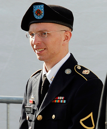 PUNISHMENT MUST BE MORE SEVERE: US Army Private First Class Bradley Manning is escorted in handcuffs as he leaves the courthouse in Fort Meade, Maryland.