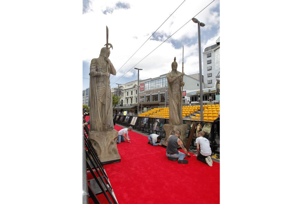 Statues of Middle-earth figures are put in place on the red carpet.