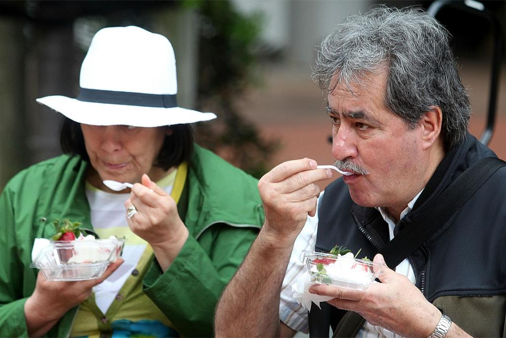 Visitors tuck into the dishes on offer at the Mercy Hospice Strawberry Festival.