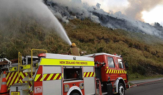 FIRE FIGHT: Crews are battling a scrub and grass fire in Mt Wellington.