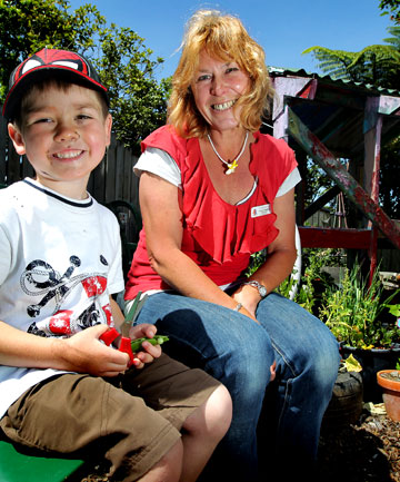 GREEN FINGERS: Frankleigh Park Kindergarten teacher Trish Crawford with Lukas Harding, 4, in the kindergarten's award-winning garden.