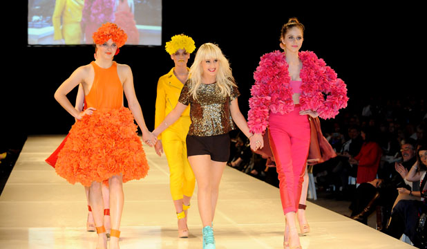 RAINBOW WALK: Design student Olivia Bloxham on the catwalk with models wearing pieces from her Colours of Us collection.