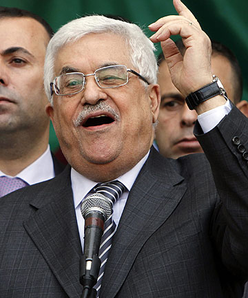 Palestinian President Mahmoud Abbas gestures as he addresses the crowd during a rally in support of his efforts to secure a diplomatic upgrade at the United Nations.