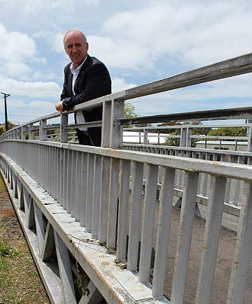COMMUNITY CONNECTION: Bob Howard on the bridge he hopes will be placed across the busy Highway 16 in Kumeu for safer access.