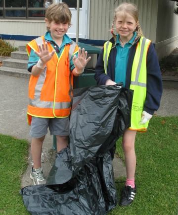 Otatara School pupils Corey Wood, 9, and Lucia Robald, 8, were involved in the Burt Munro Challenge cleanup fundraiser.