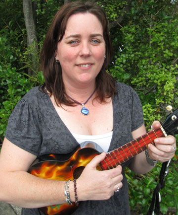 STRUMMING ON: Manuka School's Carol Davey will be leading the charge with the Kiwileles at this year's NZ Ukulele Festival at Waitakere's Trusts Stadium.