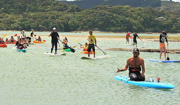 LONG JOURNEY: Dave Rastovich, bottom right, will be weclomed at Piha Beach after his paddle from Taranaki.