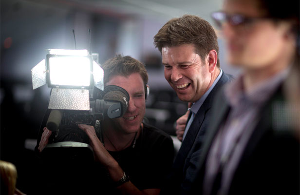 ON AIR: TV3's John Campbell at Wellington airport waits for Hobbit cast and crew to arrive.