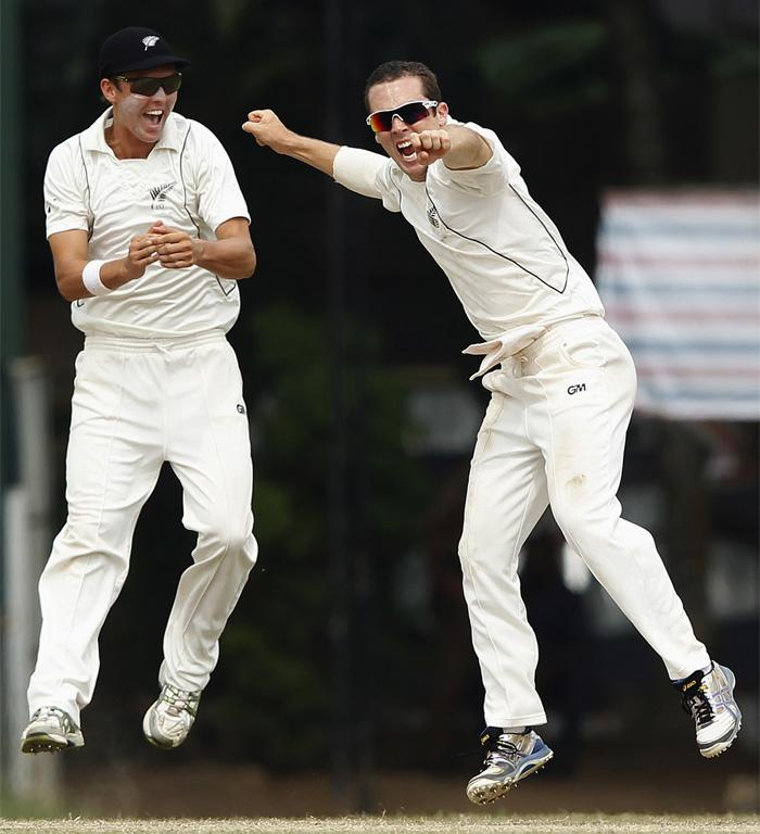 Todd Astle (right) and Trent Boult celebrate after Astle snared the vital wicket of Prasanna Jayawardene.