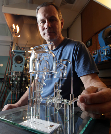 THROUGH THE LOOKING GLASS: Scientific Glassblower Steve Newcombe shows off his trophy winning glass bells.