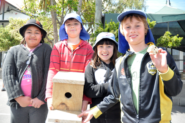 Bird house: From left, Leuaina Andrews, 8, Daniel Brooker, 9, Kawhena Vandewell, 9, and William Smith, 9, showing the bird house they made themselves.