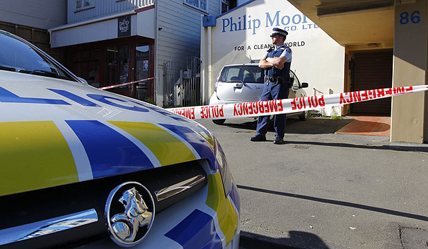 ROBBERS STRIKE: Police at Philip Moore & Co Ltd in Wellington, the scene of an armed robbery today.