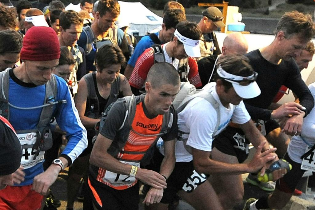 Vajin Armstrong (centre) defending champion leads the field as the 450 runners start the 2012 Kepler Challenge.