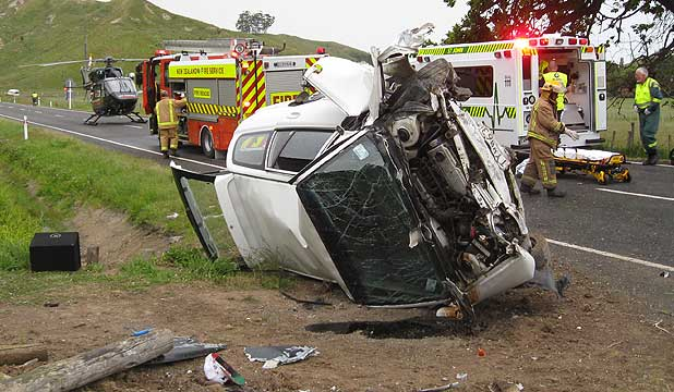 CRASH SCENE: Emergency personnel at the scene of a car crash in northern Hawke's Bay in which four men were critically injured.